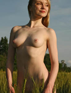Puffy nipples naked Zenya loves flowers outside in the field