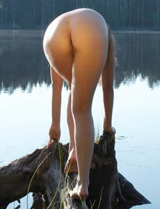 Sexy girl Lubov by the lake