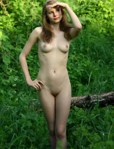 Wonderful naked Lauree in the forest