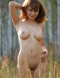 Sexy naked Larisa in the forest