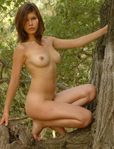 Hairy beaver young Jula nude in the forest with her nipples puffy