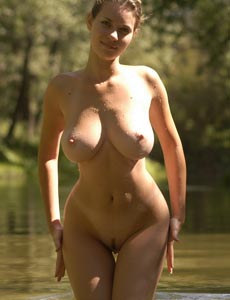 Young goddess Gigi has huge boobs and hairy pussy walking nude and swimming nude in the lake