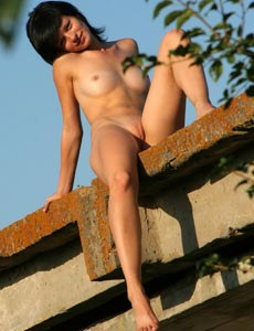 Round ass Ellina posing outside