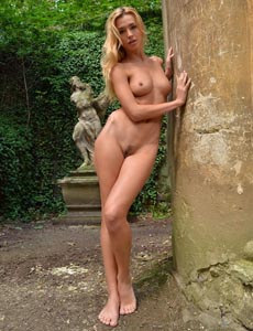 Blonde Dominga with hairy beaver nude outside