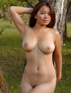 Busty latin Aynur with hairy beaver playing nude in the forest