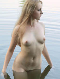 Teen goddess Alena swimming in the lake