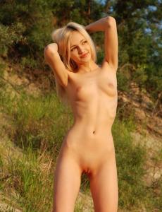 Petite blonde Aleksandra shows herself nude outside