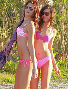 Sexy twins Gia and Noma are outdoor in pink bikinis and nude