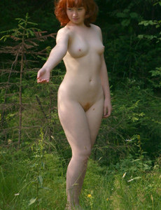 Hairy pussy young redhead Ginger is nude in the forest with hairy beaver and puffy nipples