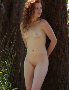 Redhead beautiful Ginger is nude in the forest showing her sexy body with puffy nipples
