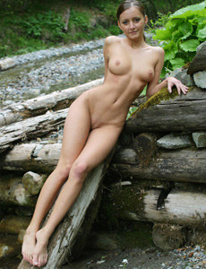 Exciting beautiful Nicol is nude in the deep forest