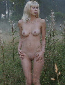 Nice blonde Nataly is nude with puffy nipples in the field