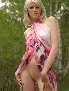 Blonde Kissa takes off her clothes outside