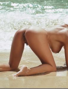 Busty hairy pussy brunette Kerstin in bikini in the sea