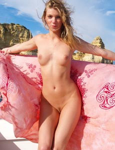 Edita young nudist in the boat