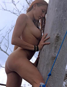 Exciting perfect round ass Angeli nude outside on the big tree