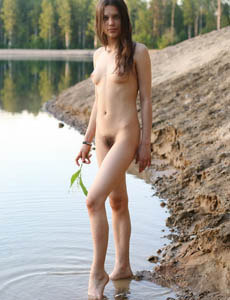 Hairy pussy Marinna playing in the lake
