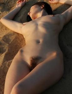 Hot brunette Elenia on the beach showing her hairy slut