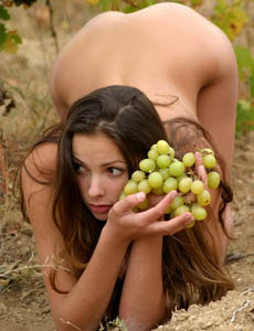 Nude Allida outside gathering and eating the grape nude