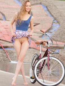 Sexy Eugena strips to go cycling nude